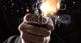 stock-photo-killer-with-gun-close-up-on-dark-background-258823379