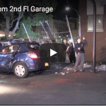 Car falls from 2nd Fl Garage